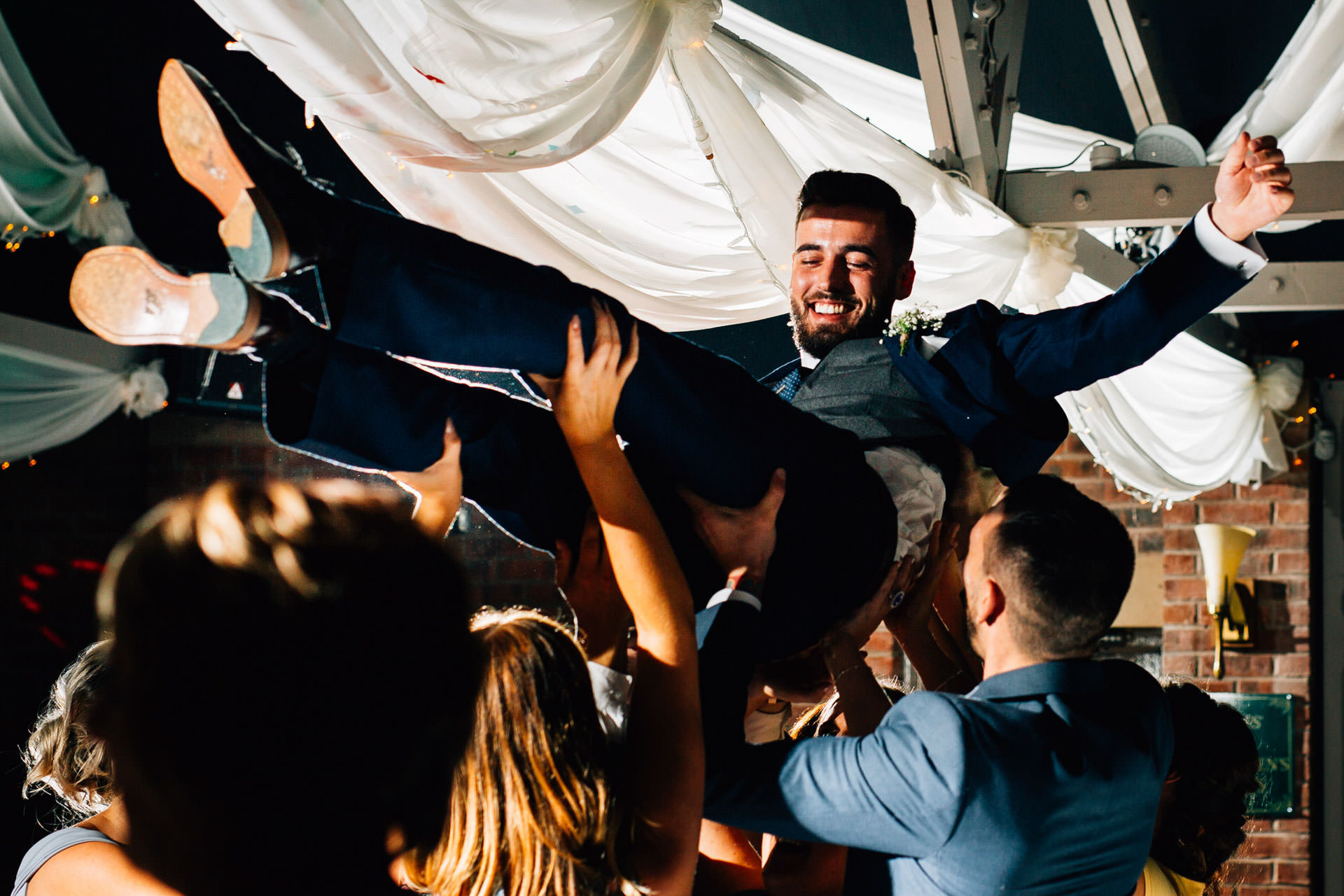 Best wedding photography 2016 - lifting up the groom in the air