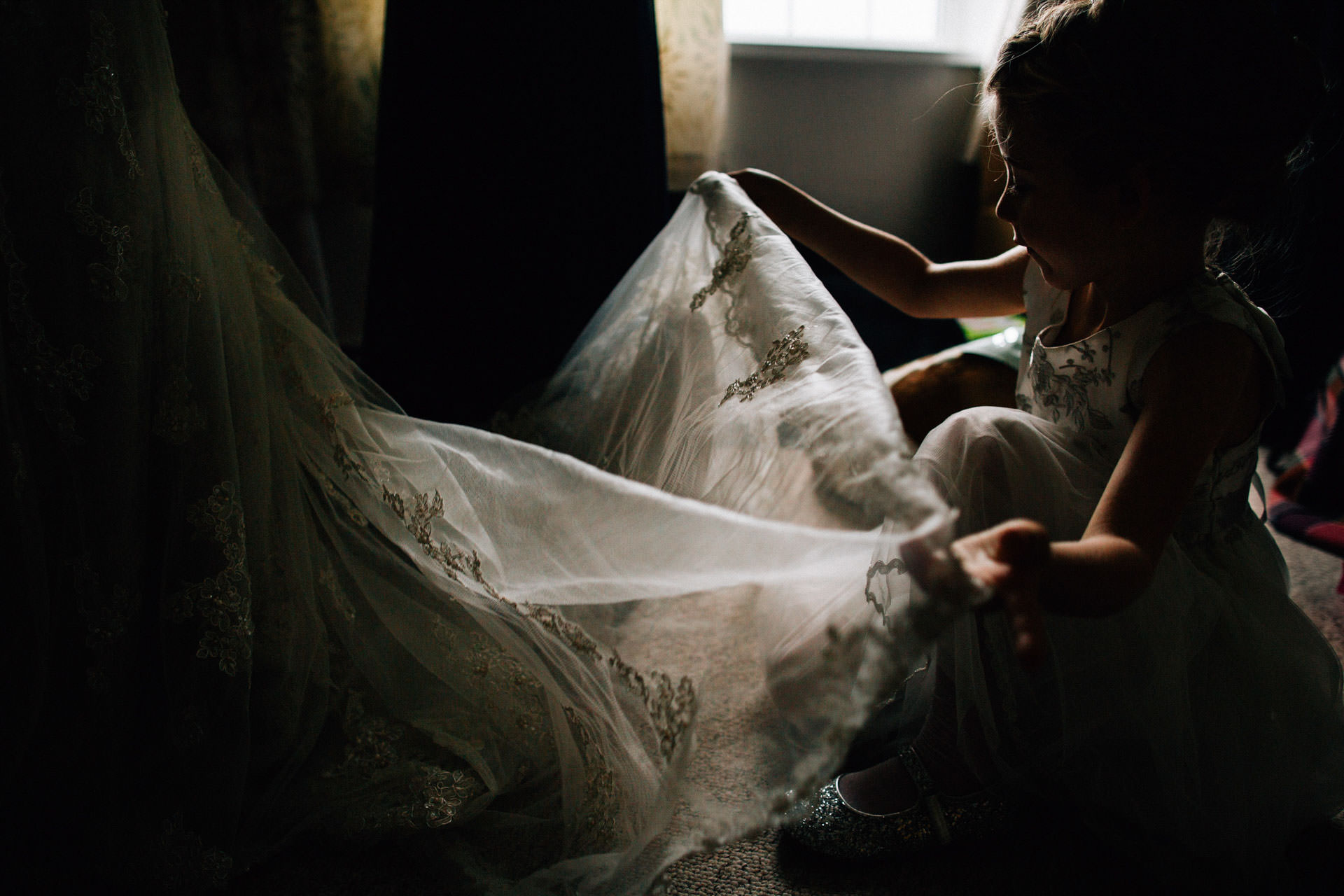 Best wedding photography 2016 - bridesmaid playing with veil