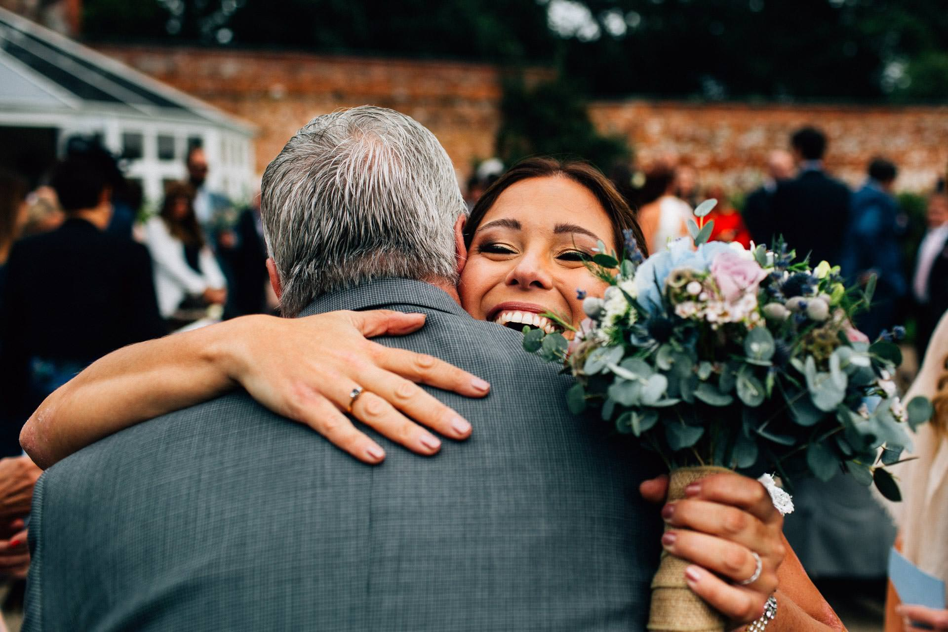 Best wedding photography 2016 - bride hugging her uncle