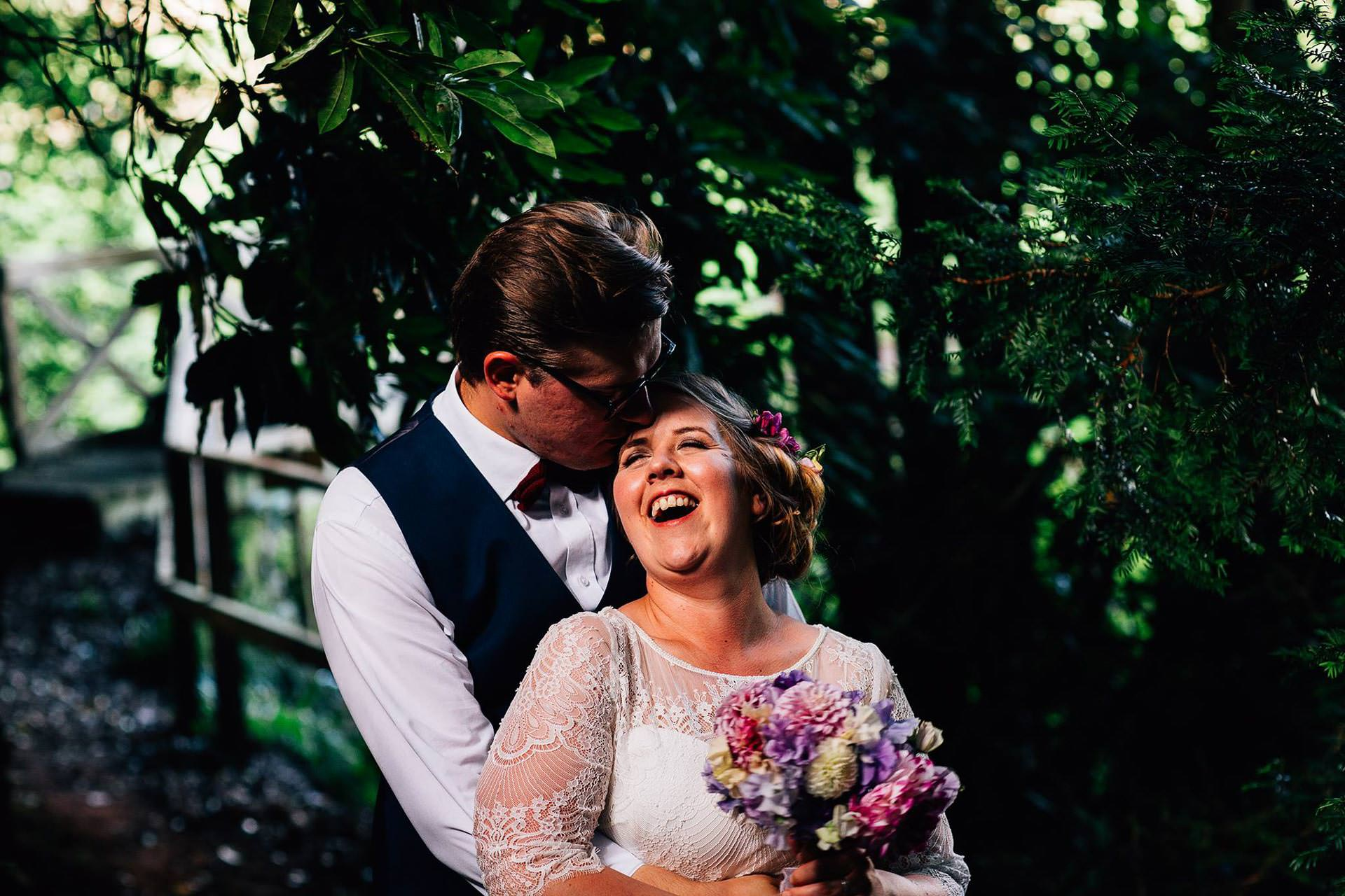 Best wedding photography 2016 - bride and from laughing in the woods