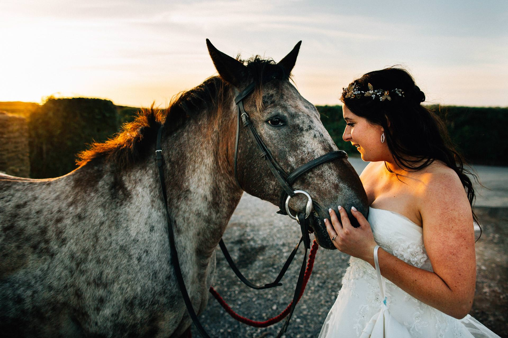 Best wedding photography 2016 - bride with horse at sunset