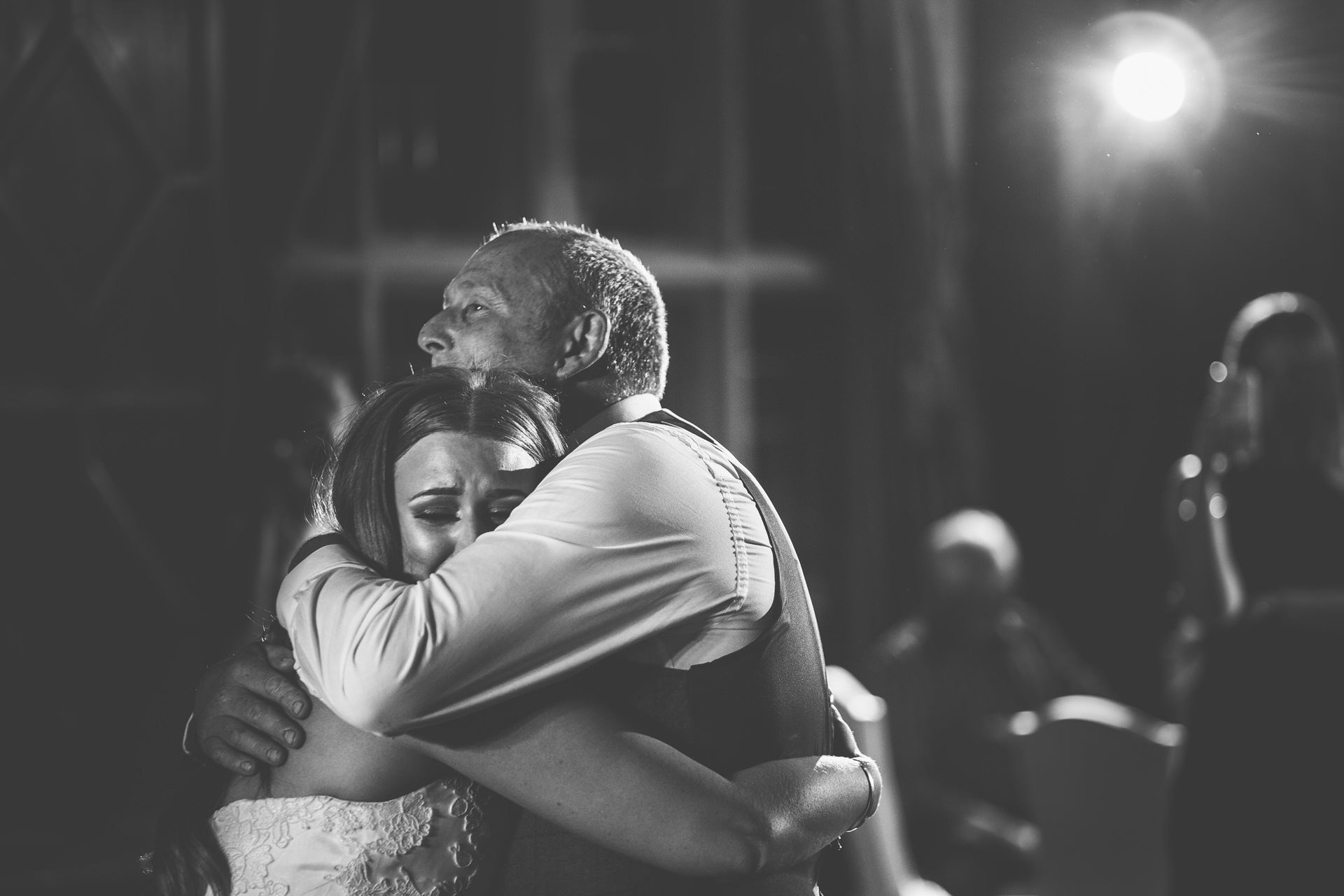 Best wedding photography 2016 - black and white of bride and dad hugging