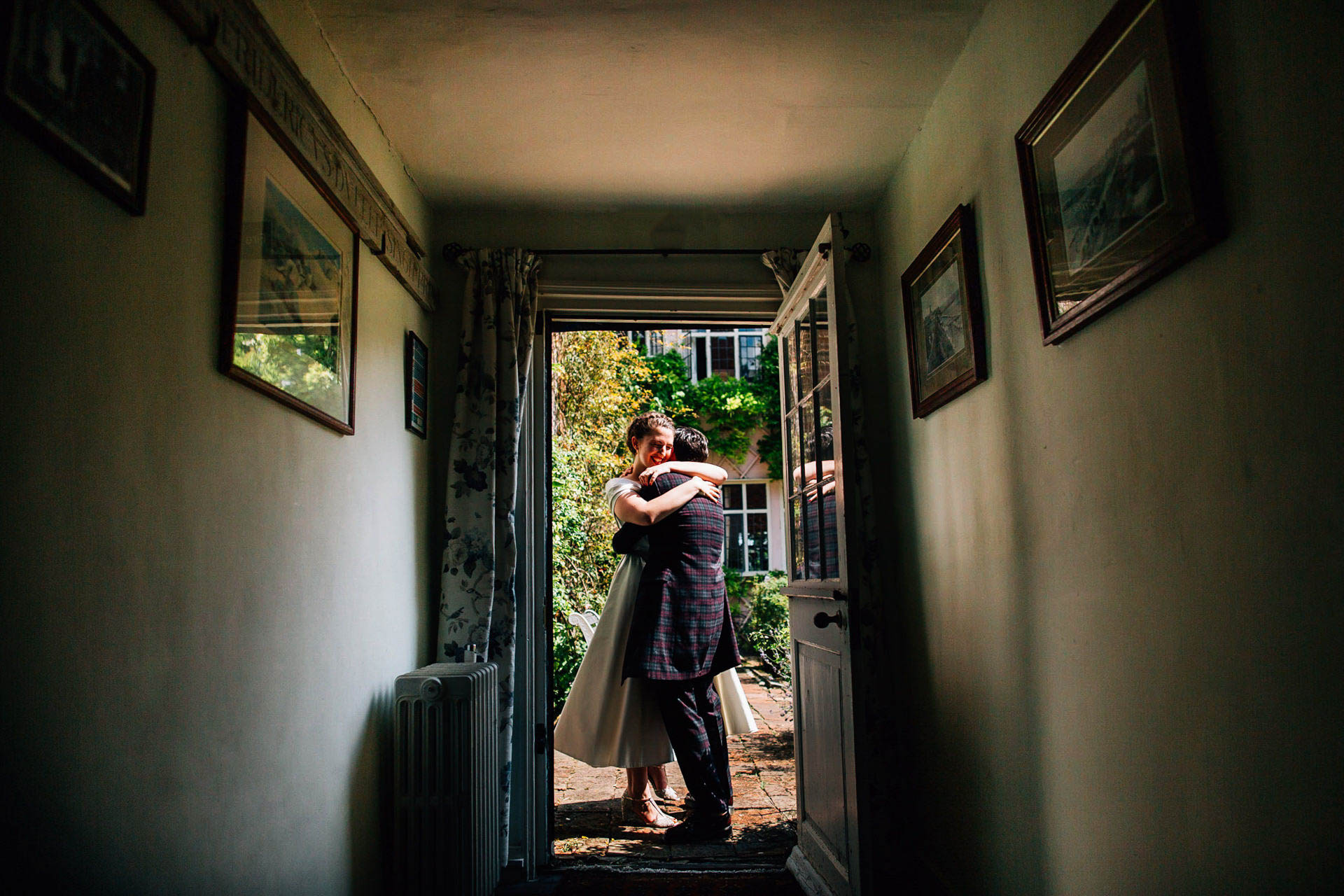 Best wedding photography 2016 - brides hugging in doorway of gorgeous house
