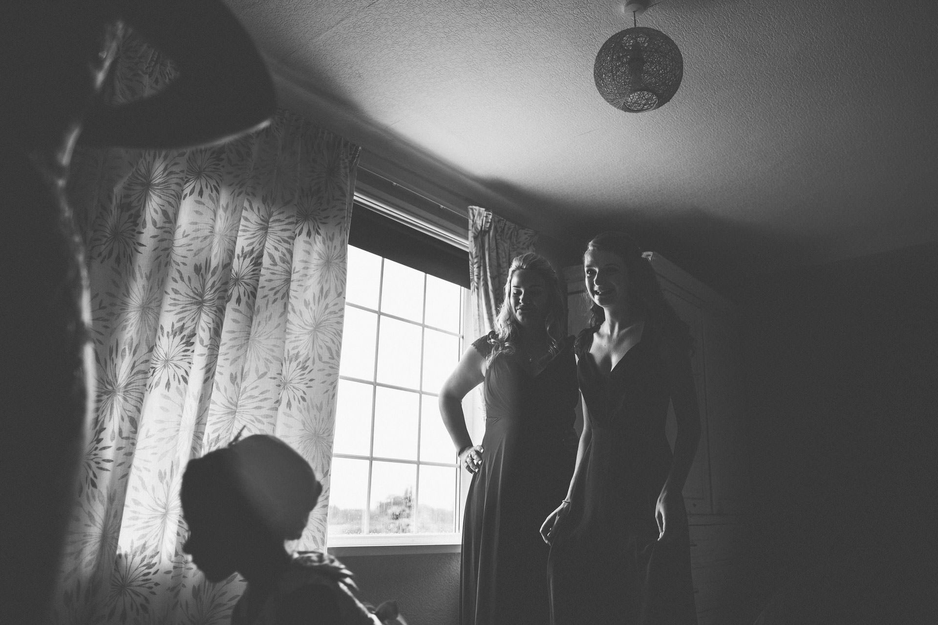 Best wedding photography 2016 - bridesmaids sorting out the wedding dress