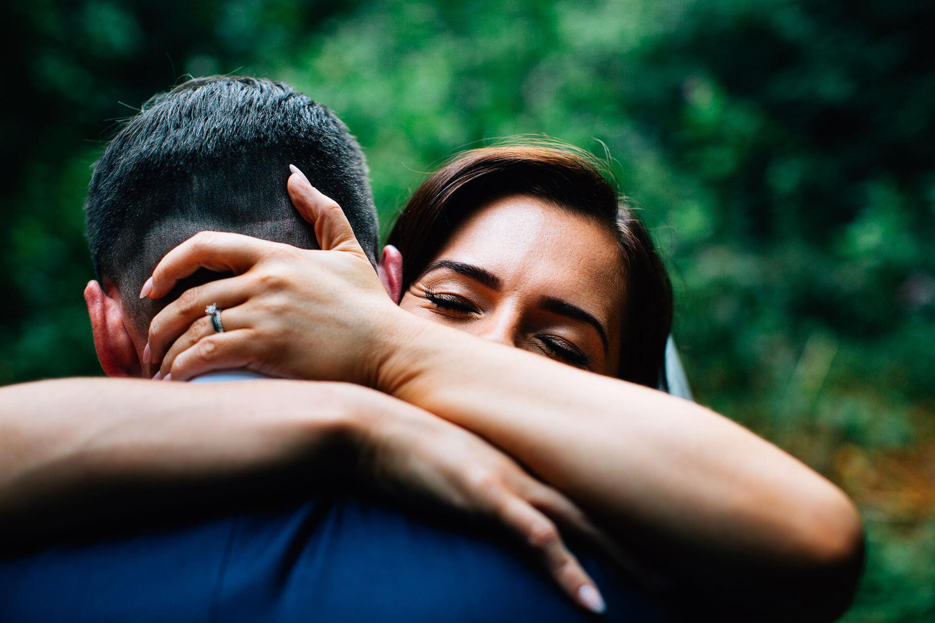 Creative Documentary Wedding Photographer UK and Destination - brides face hugging groom