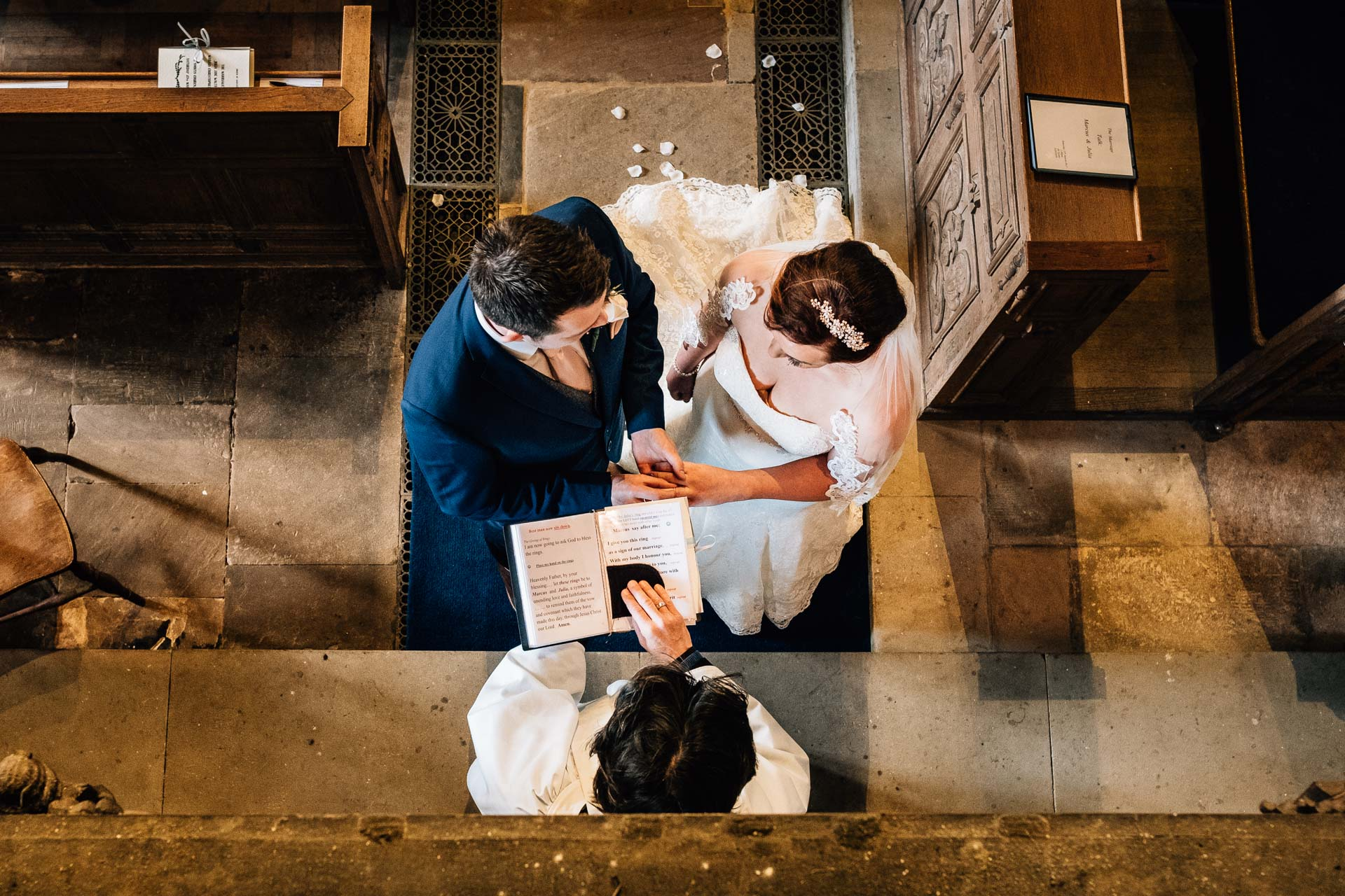 Sandon Hall Wedding Photography - J&M - exchanging vows shot from above
