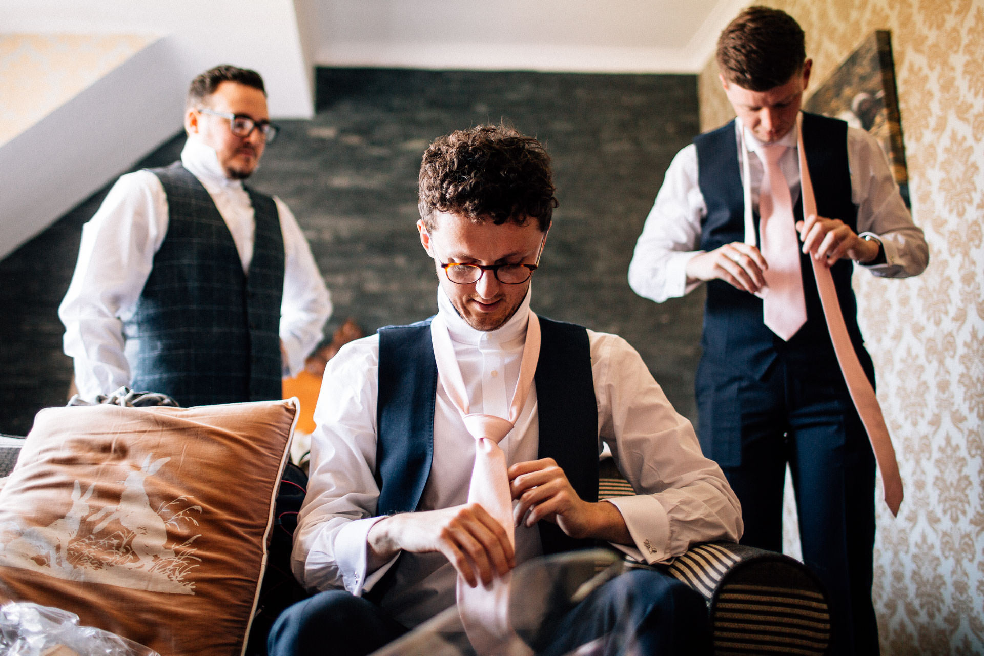 The Wild Boar Wedding Photography - EM - groomsmen preparing in the morning