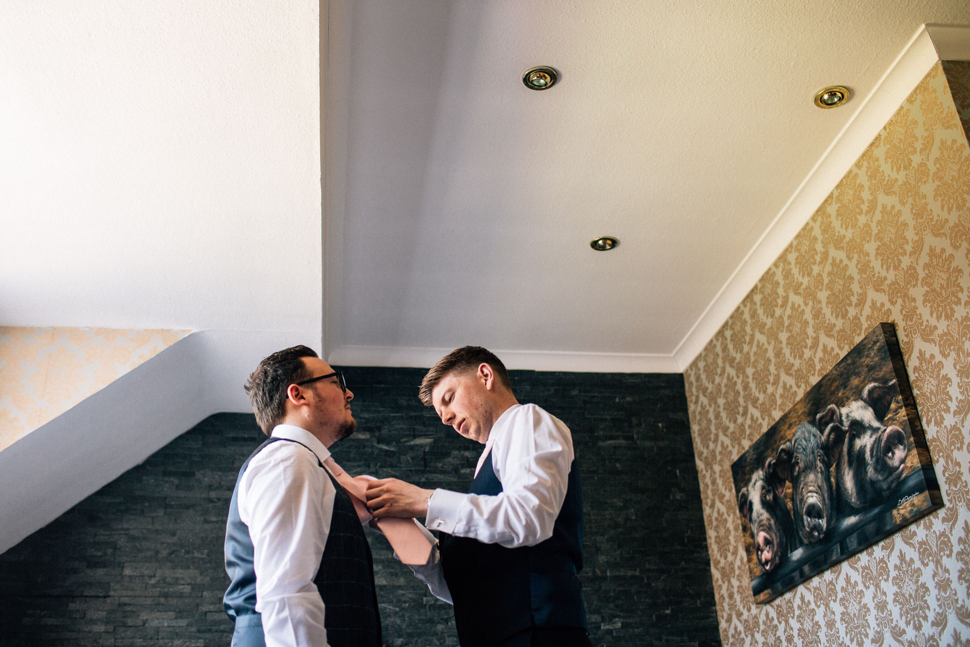 The Wild Boar Wedding Photography - EM - groom having his tie put on