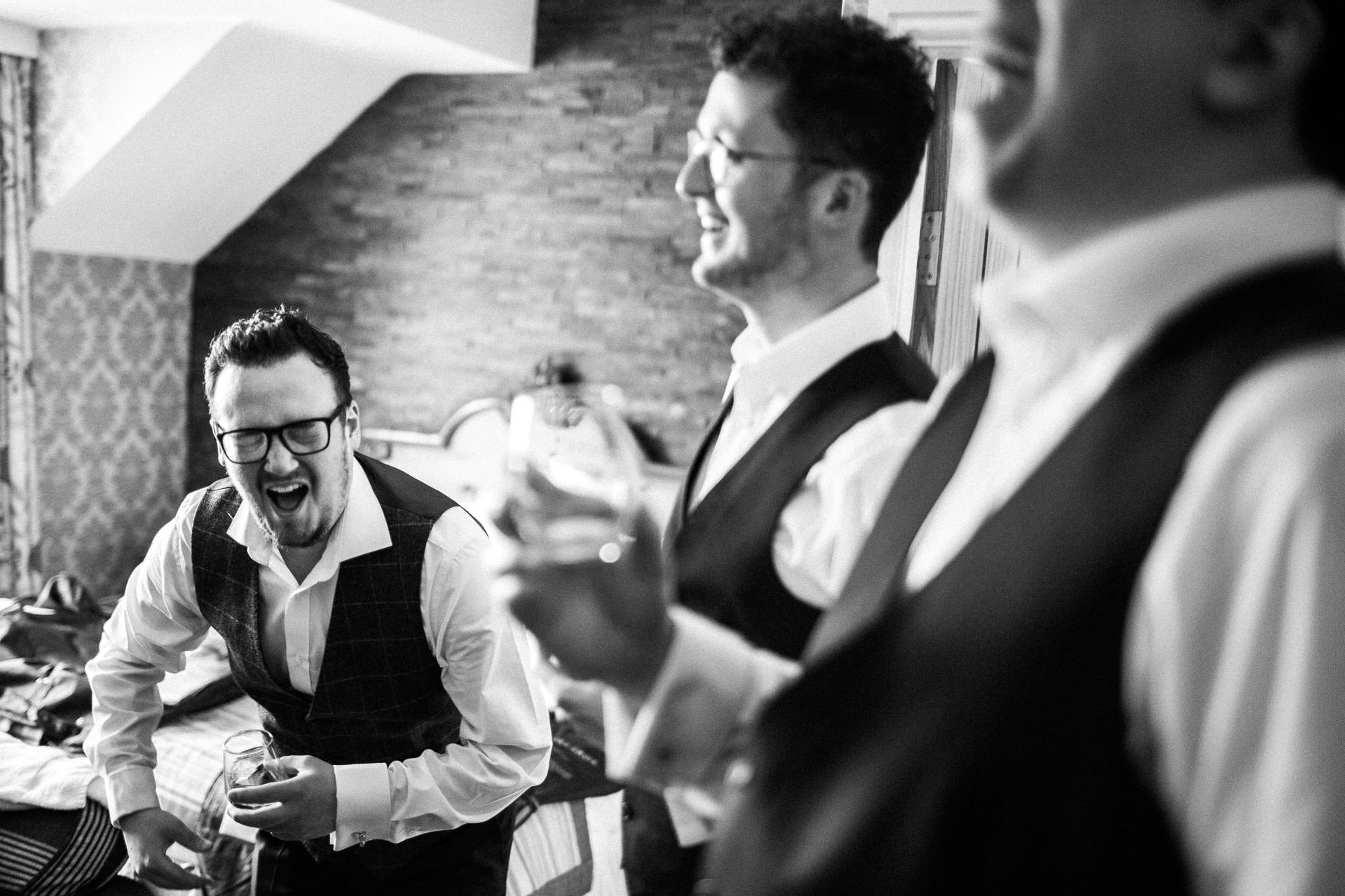 The Wild Boar Wedding Photography - EM - groom and best man in the morning