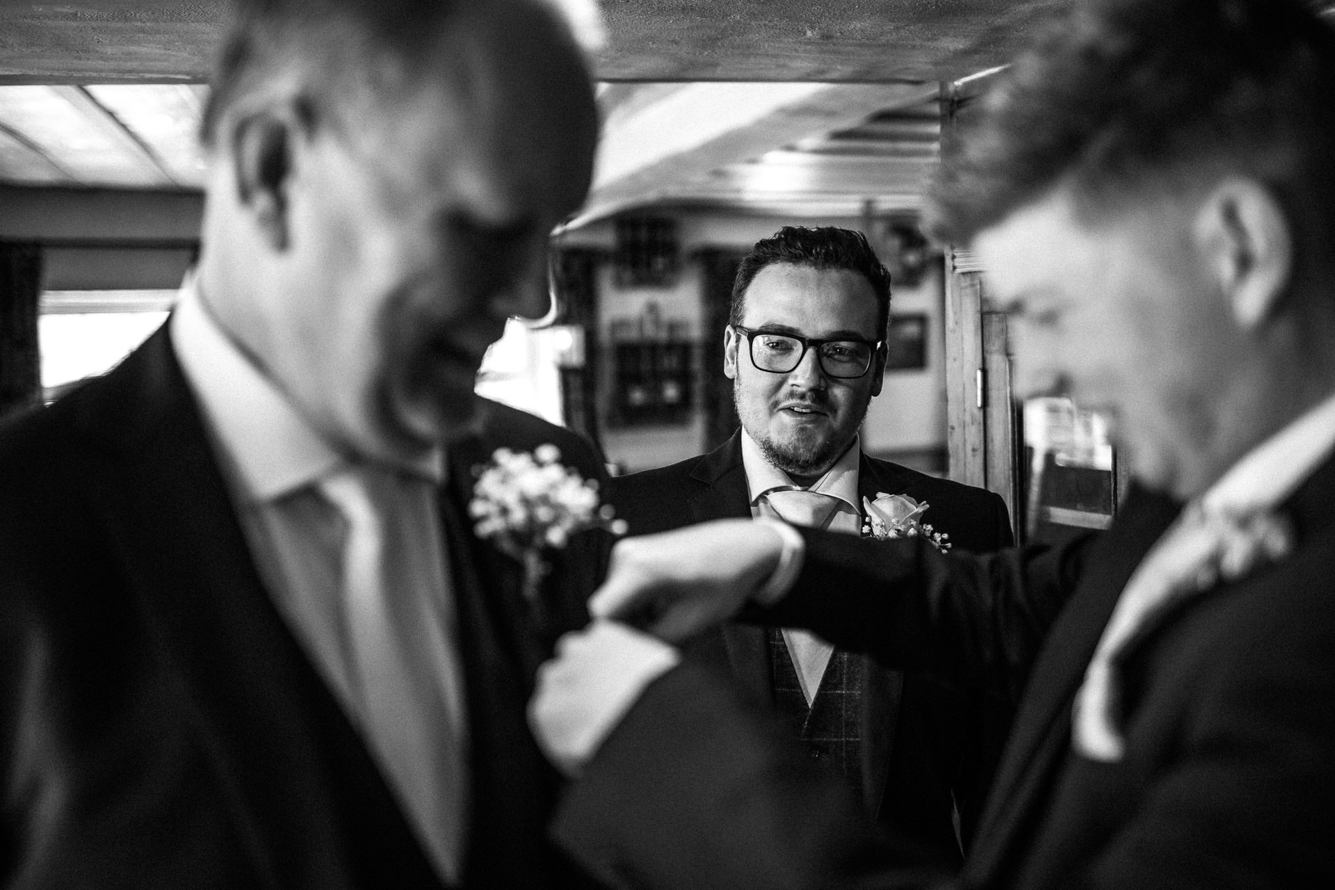 The Wild Boar Wedding Photography - EM - groom watching ties being put on