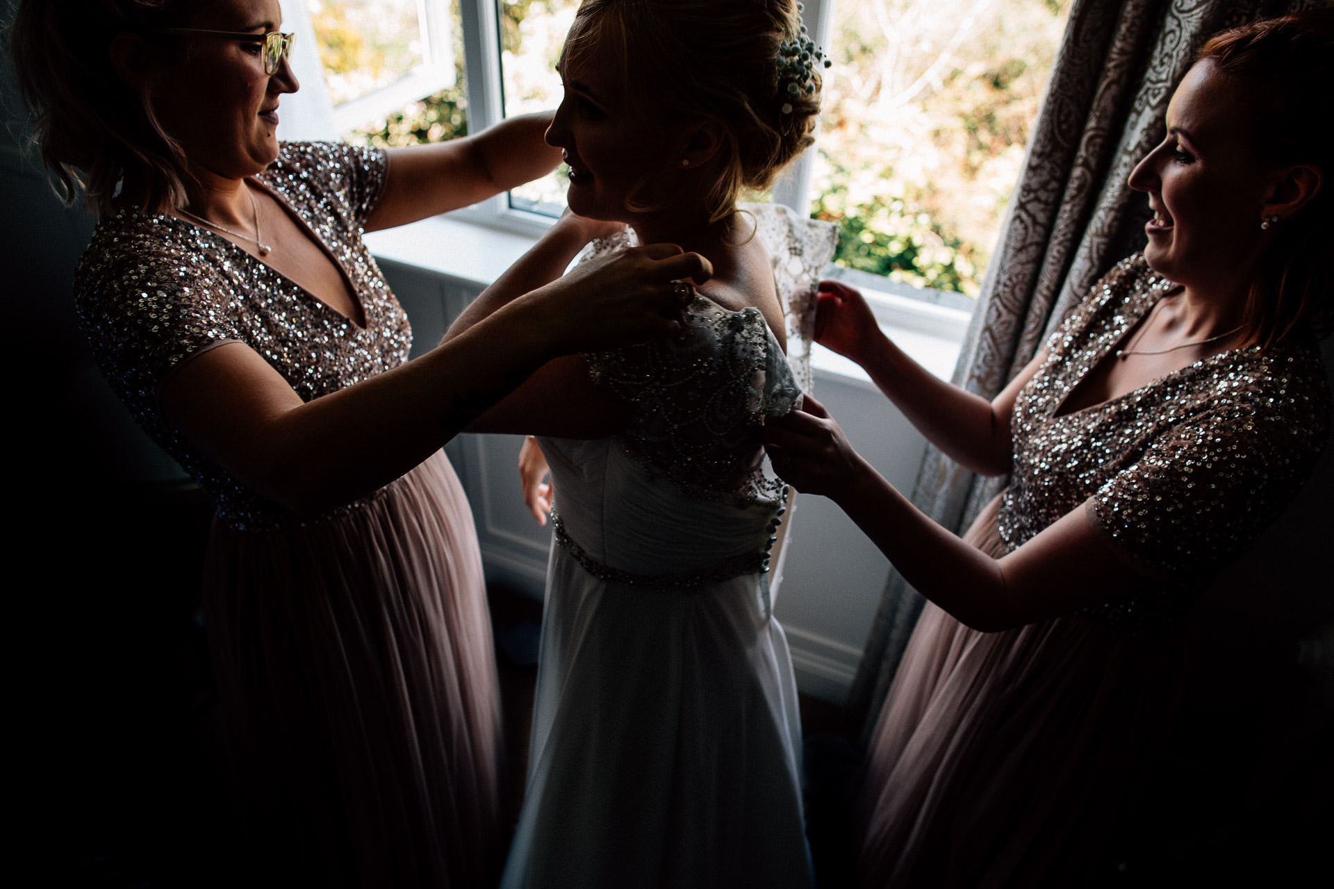 The Wild Boar Wedding Photography - EM - bride putting on her dress