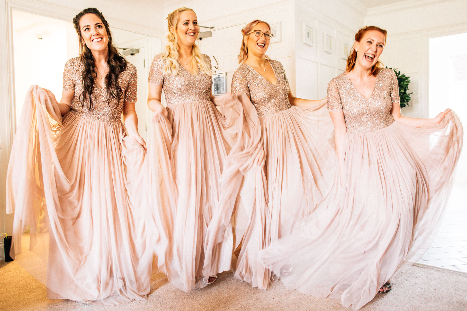 The Wild Boar Wedding Photography - EM - bridemaids swishing dresses
