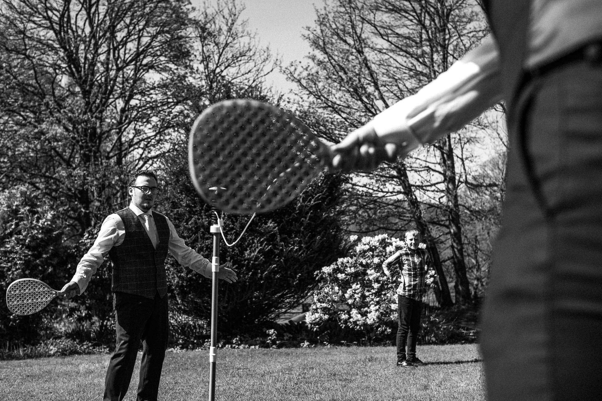 The Wild Boar Wedding Photography - EM - swingball before the ceremony