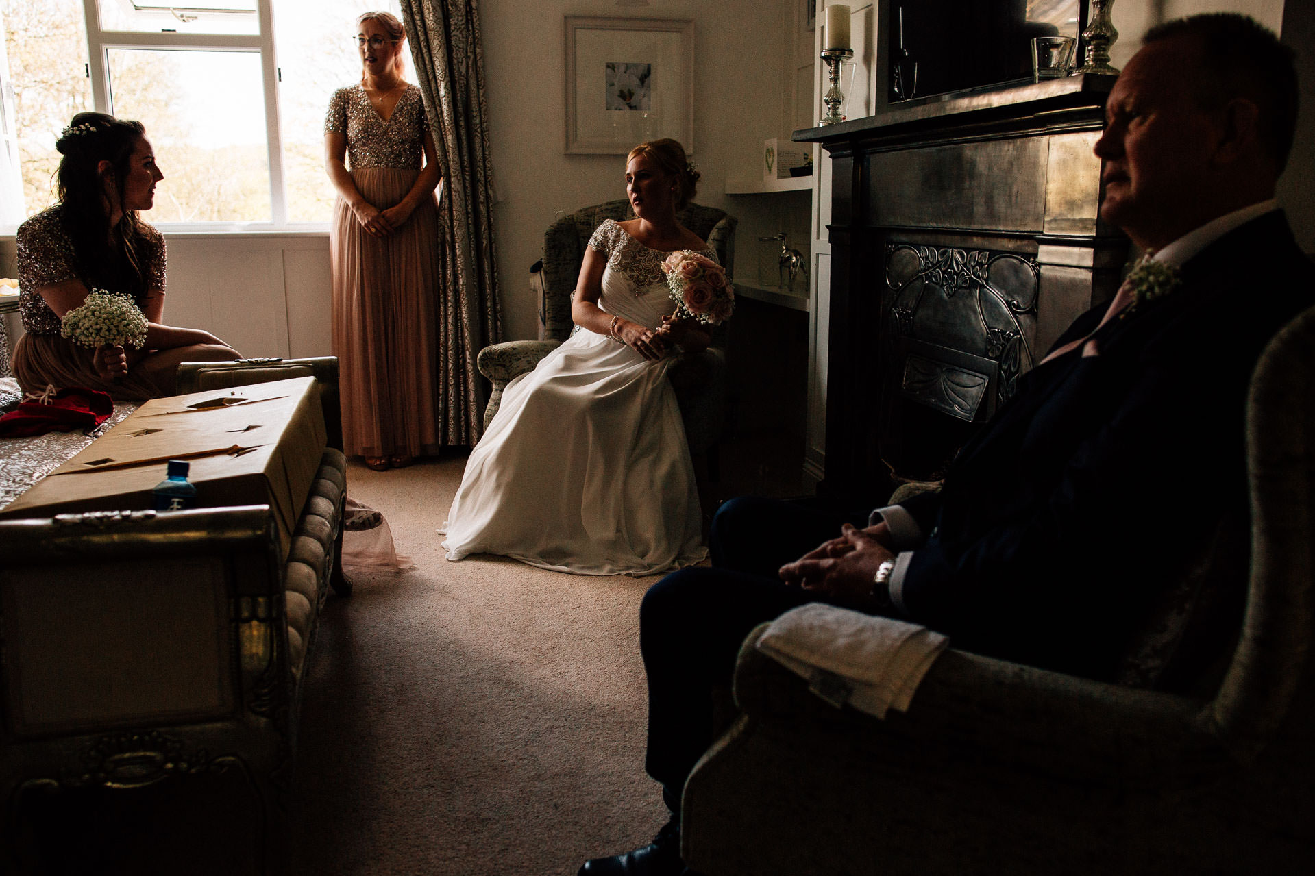 The Wild Boar Wedding Photography - EM - bride and maids sitting and waiting