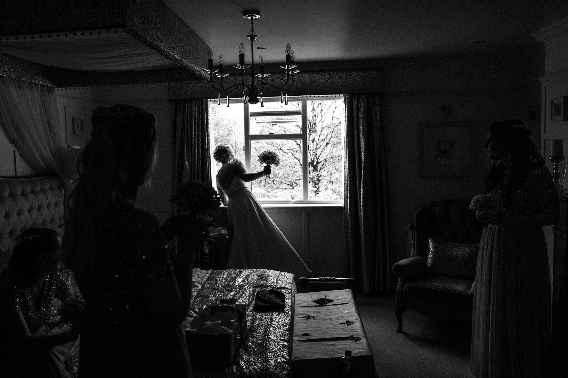 The Wild Boar Wedding Photography - EM - bride looking out of the window