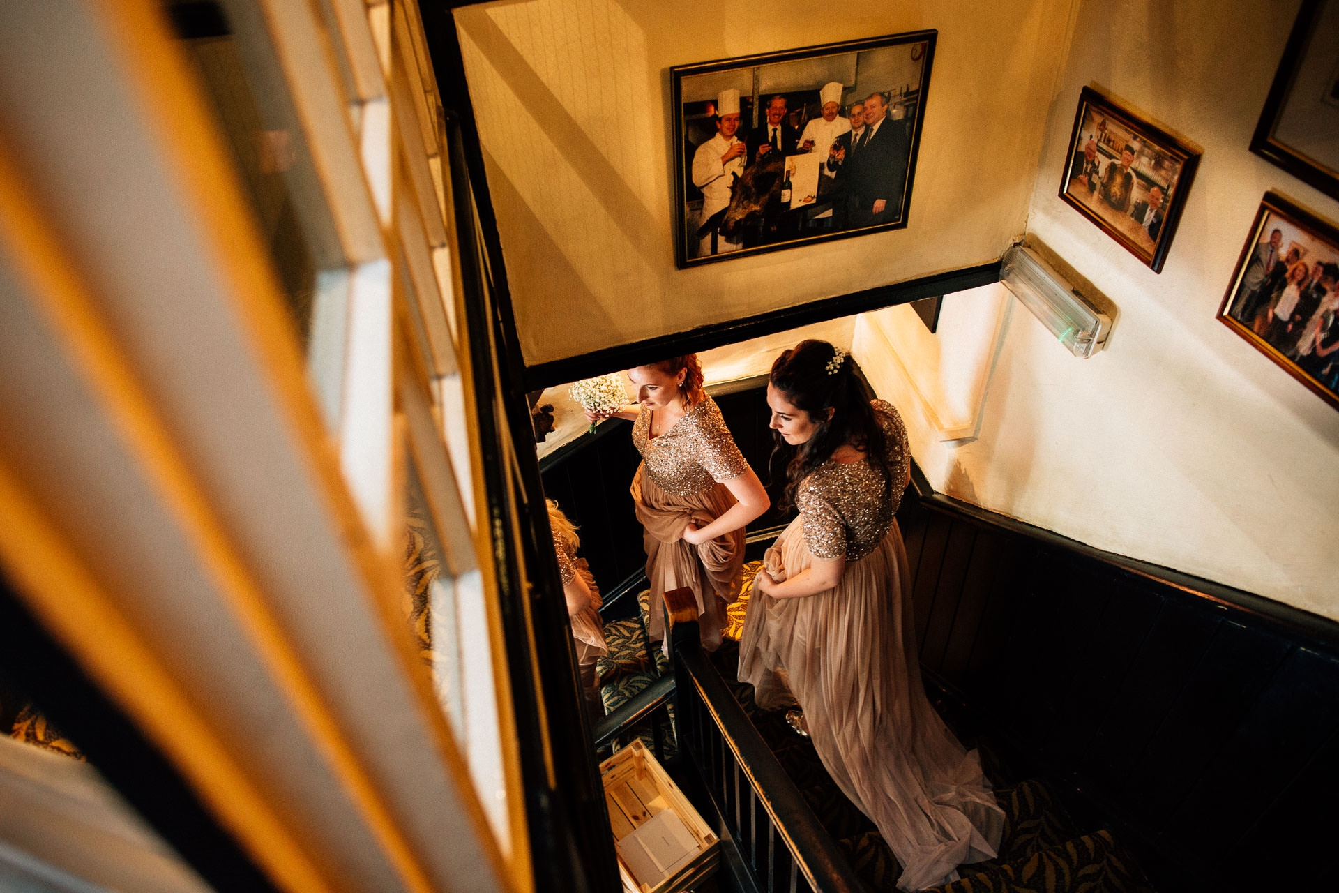 The Wild Boar Wedding Photography - EM - bridesmaids walking down the stairs