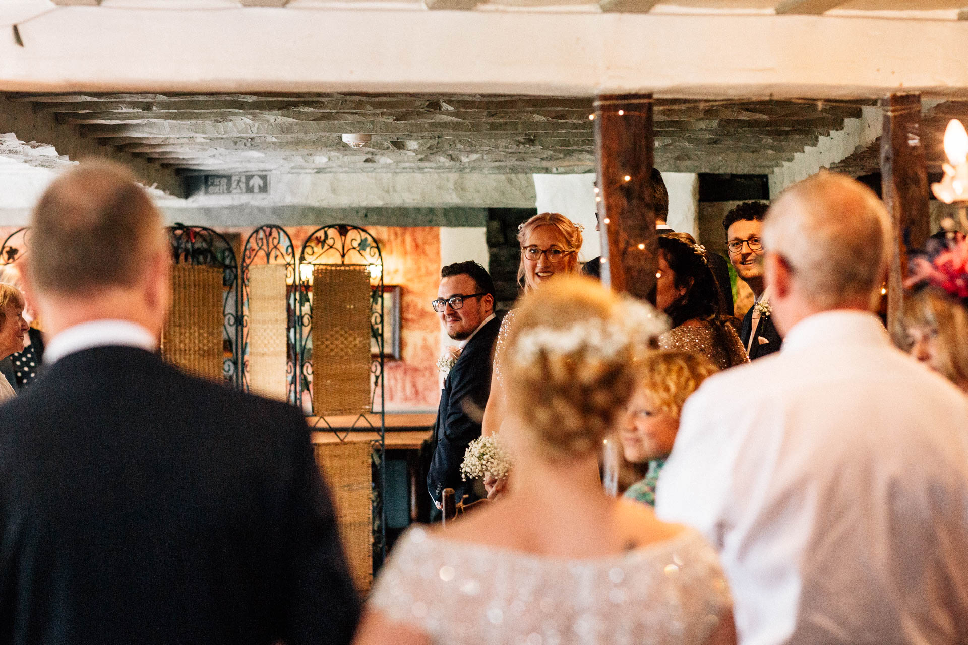 The Wild Boar Wedding Photography - EM - grooms reaction to bride walking down the aisle