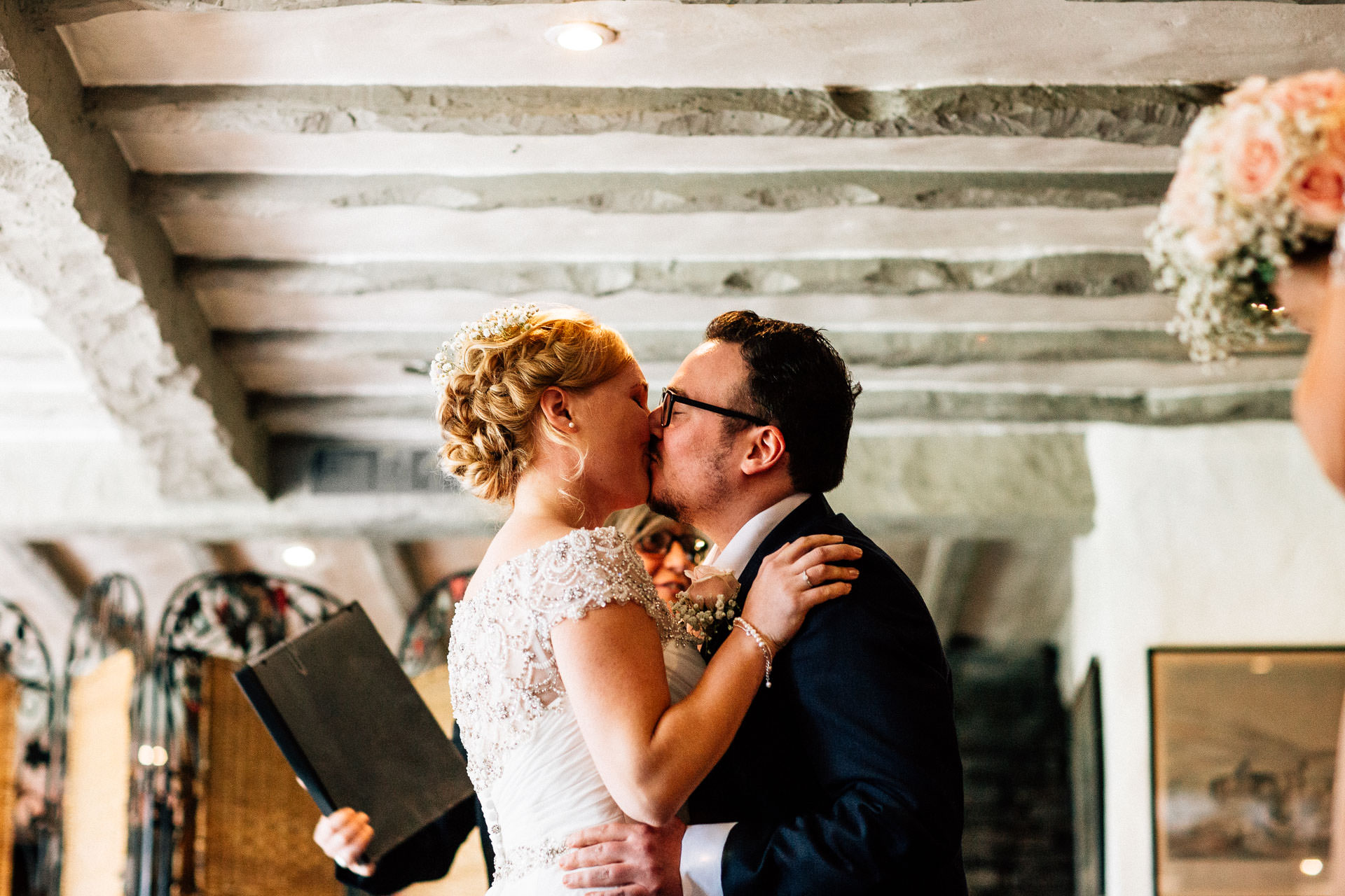 The Wild Boar Wedding Photography - EM - couples first kiss
