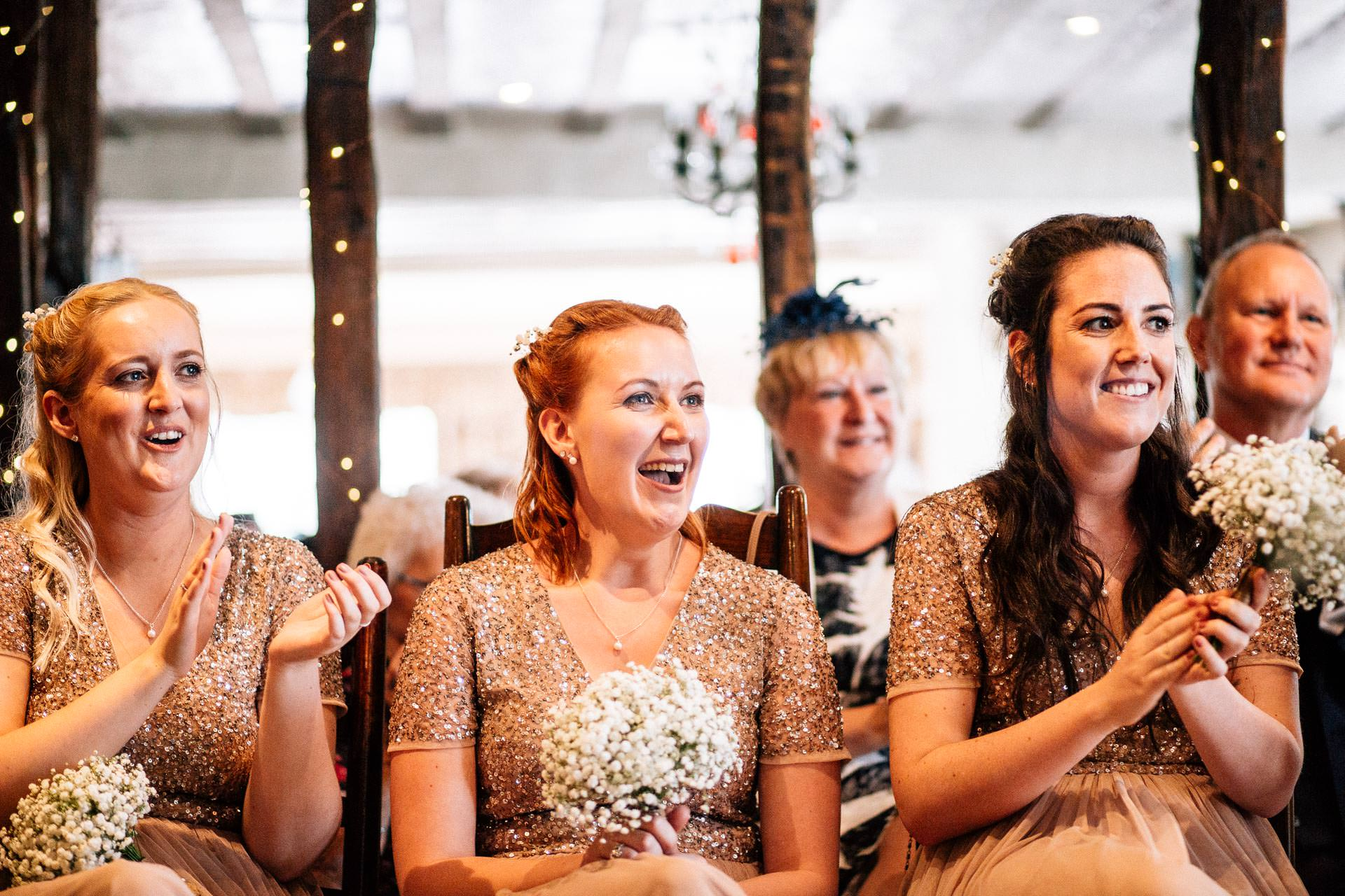 The Wild Boar Wedding Photography - EM - bridesmaid laughgin during end of ceremony