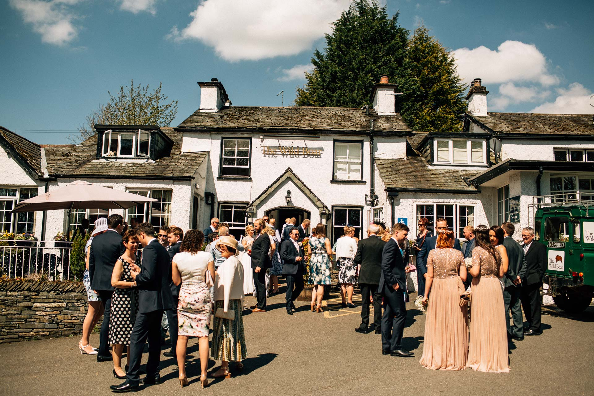 The Wild Boar Wedding Photography - EM - wide shot of venue with guests outside