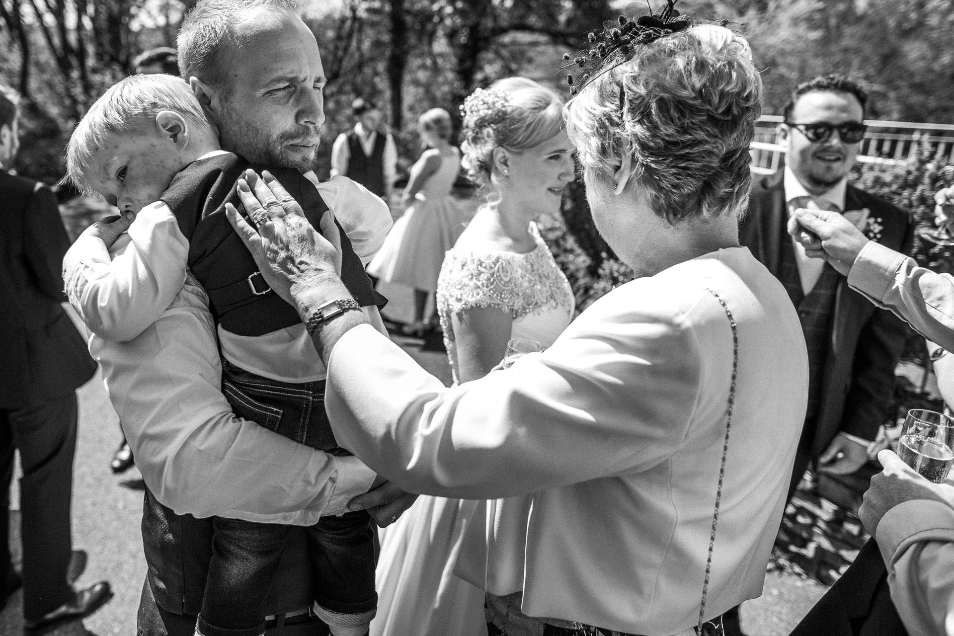 The Wild Boar Wedding Photography - EM - guests congratulating couple