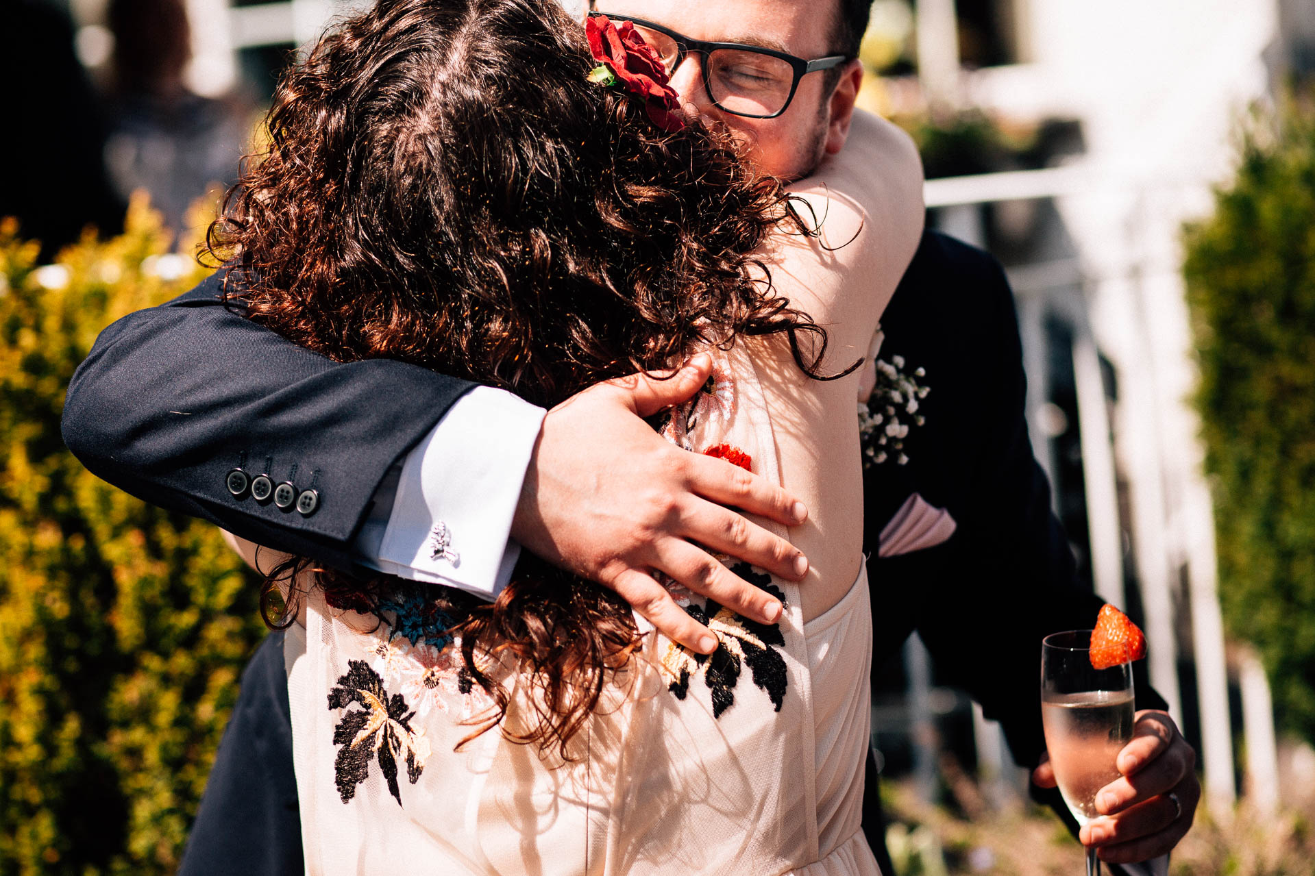 The Wild Boar Wedding Photography - EM - groom hugging his sister