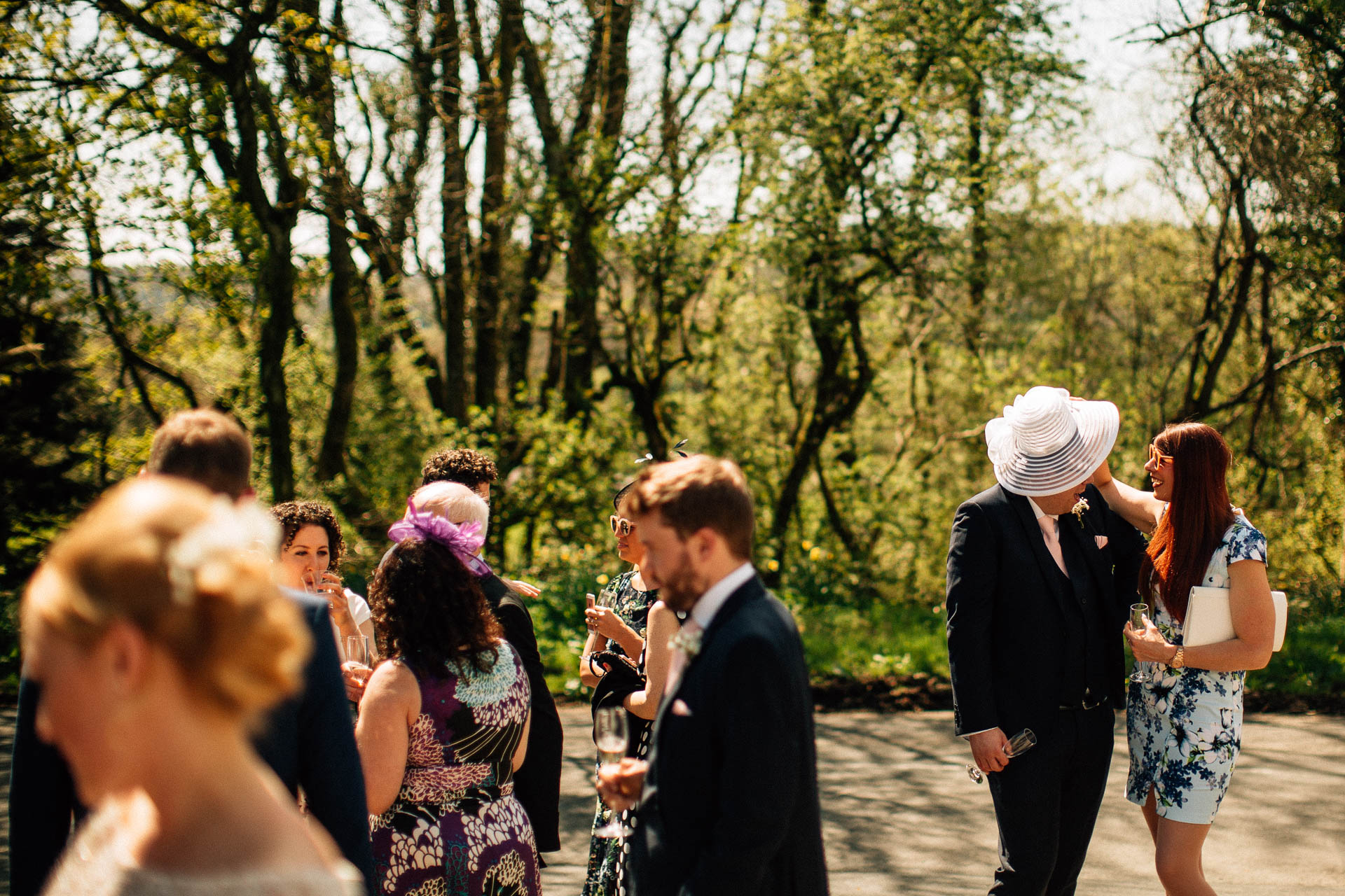 The Wild Boar Wedding Photography - EM - guests chatting