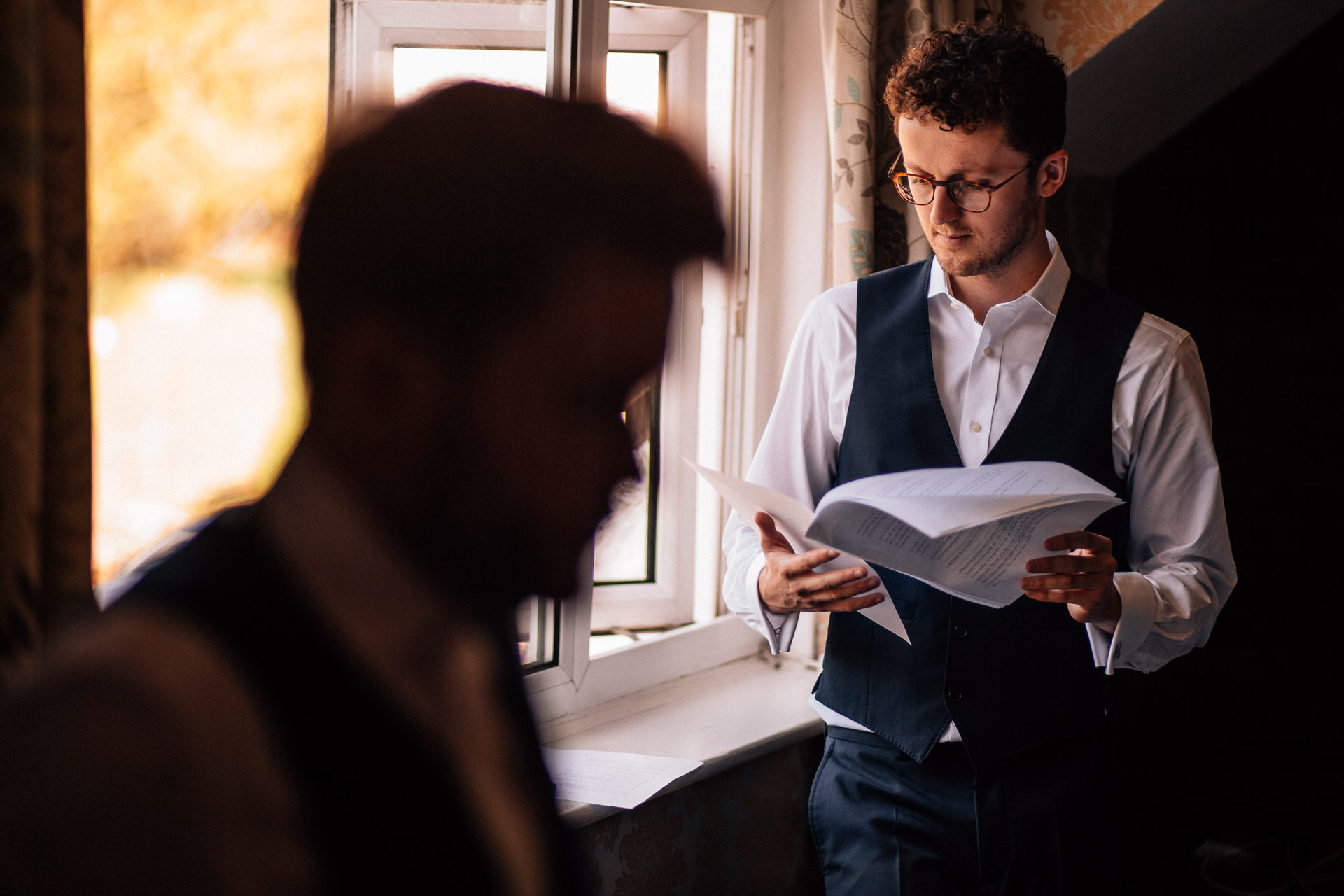 The Wild Boar Wedding Photography - EM - best man reading speech in the window
