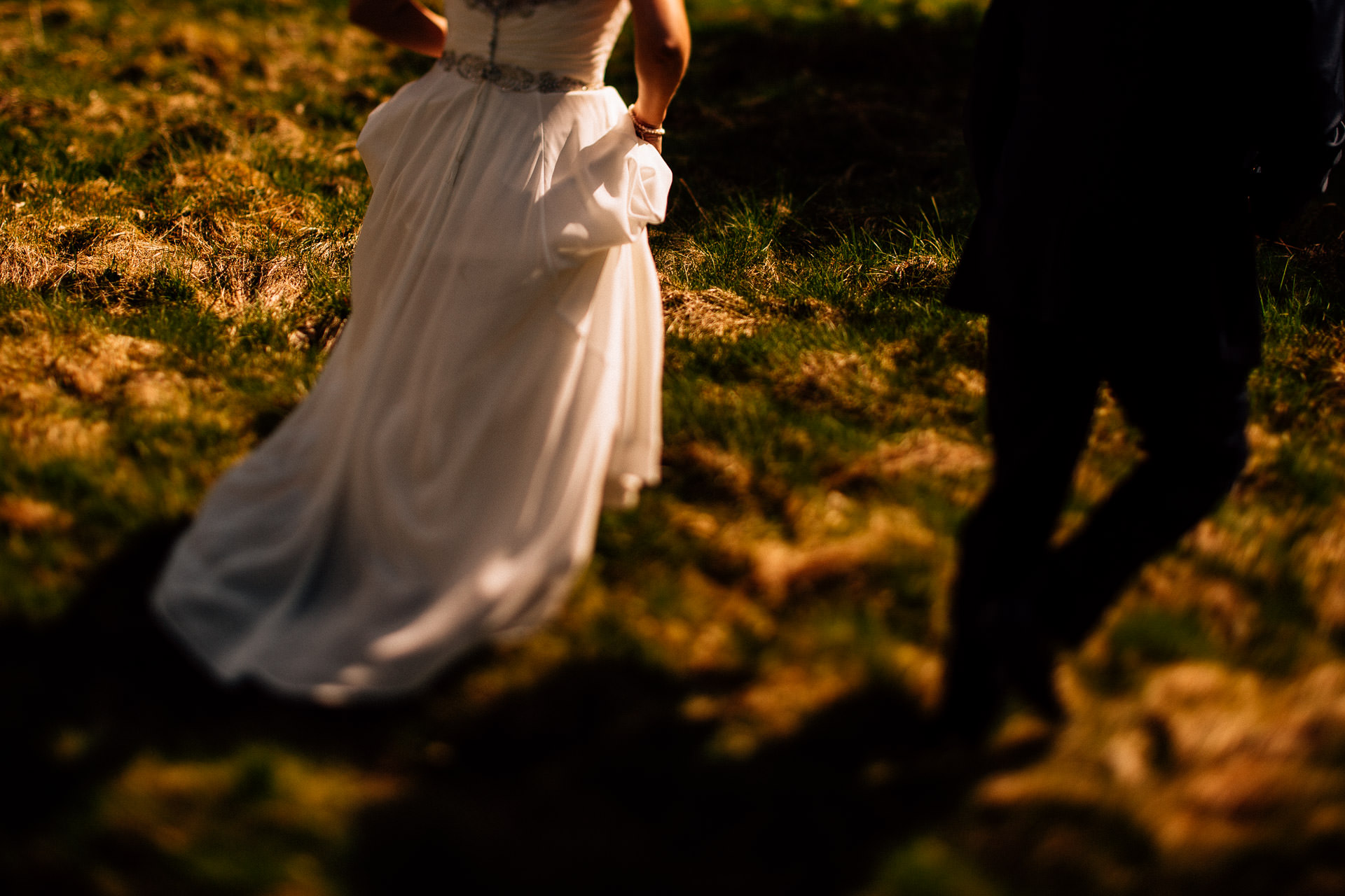 The Wild Boar Wedding Photography - EM - bokeh shot of couple walking at sunset