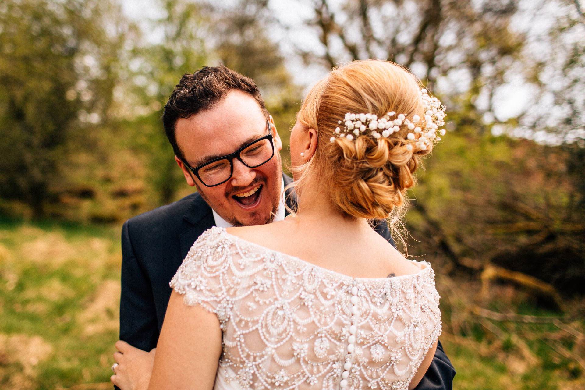 The Wild Boar Wedding Photography - EM - groom laughing during portraits