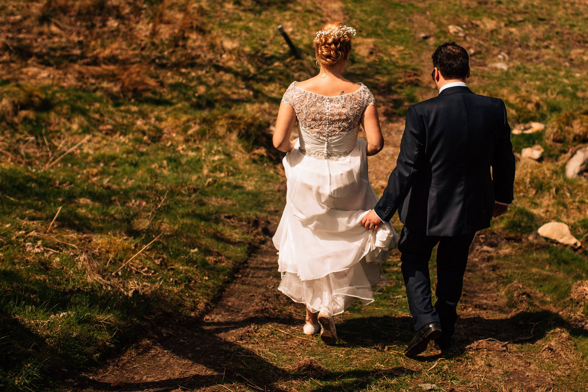 The Wild Boar Wedding Photography - EM - bride and groom walking together