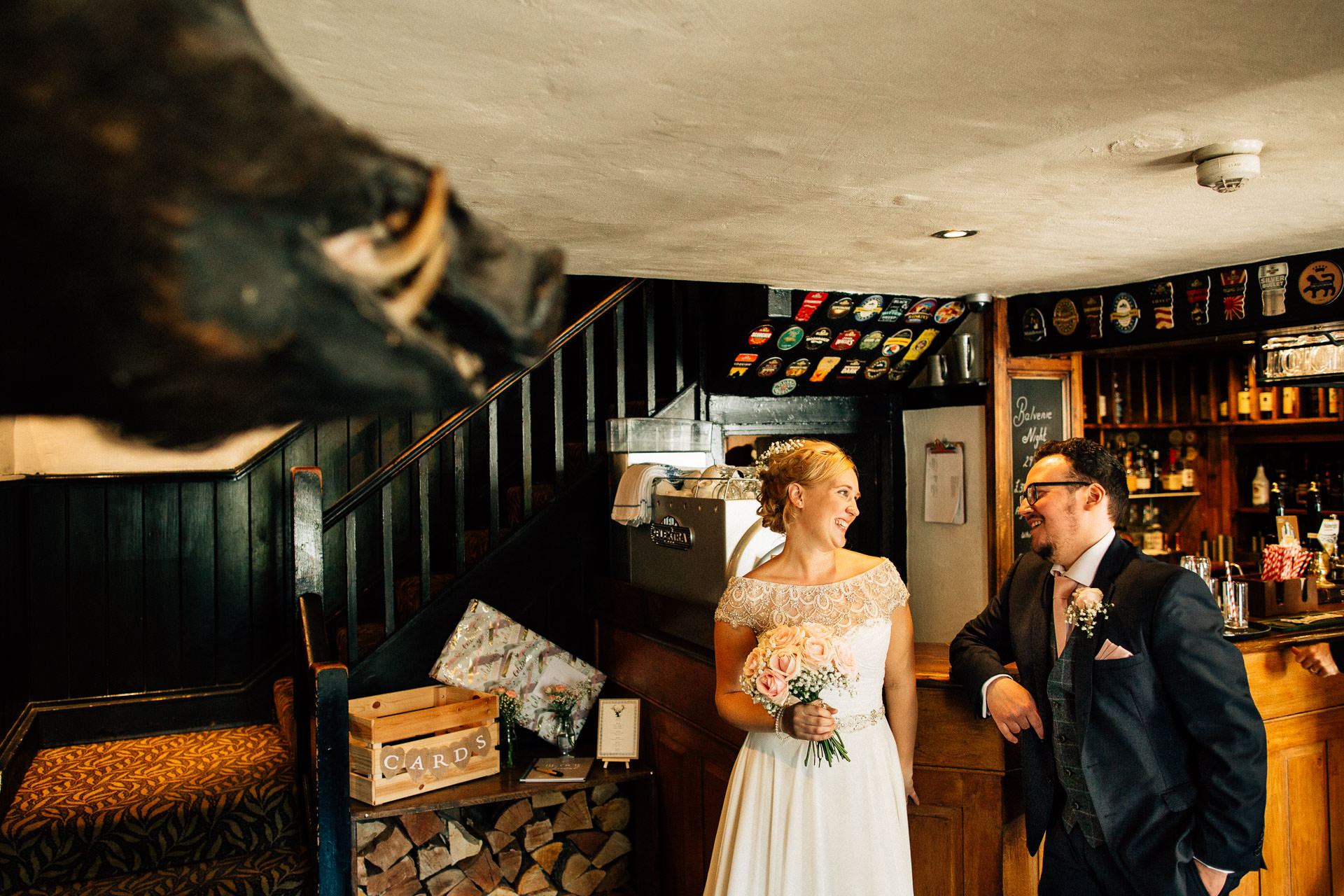 The Wild Boar Wedding Photography - EM - bride and groom waiting to enter the room