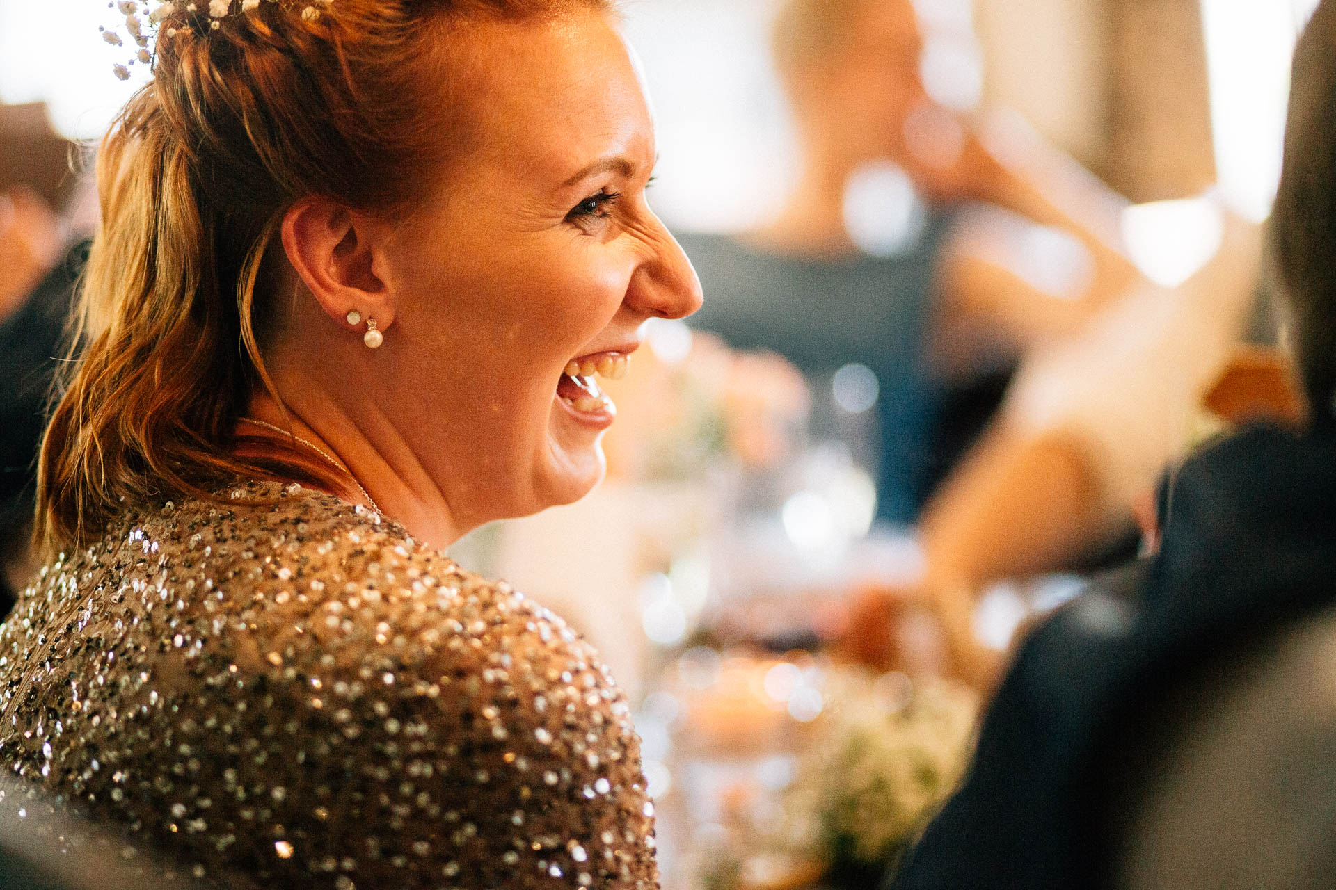The Wild Boar Wedding Photography - EM - bridesmaid laughing during speeches