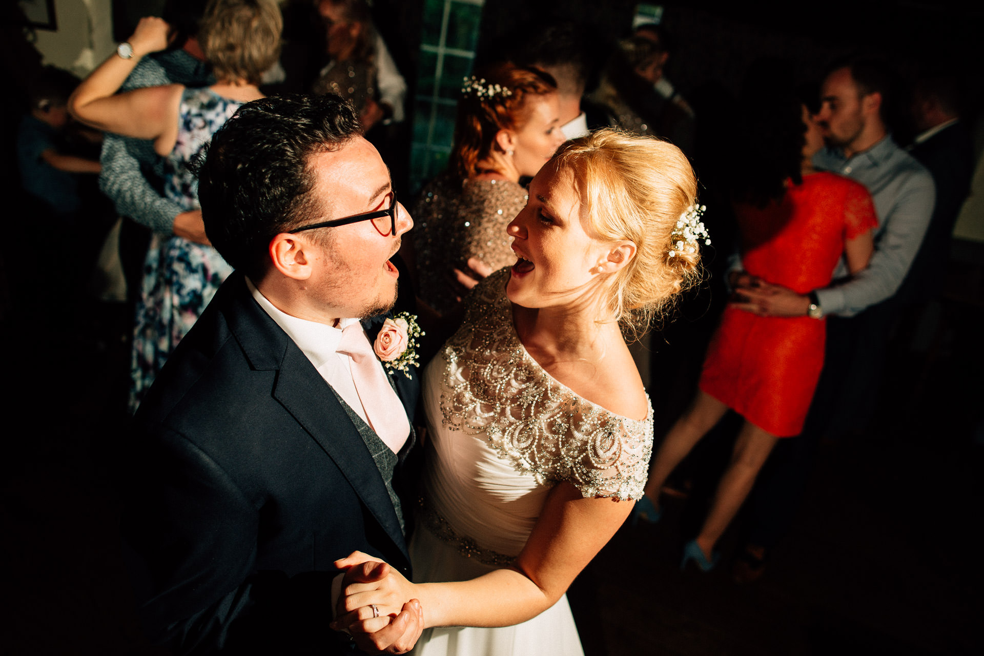 The Wild Boar Wedding Photography - EM - couple dancing with guests