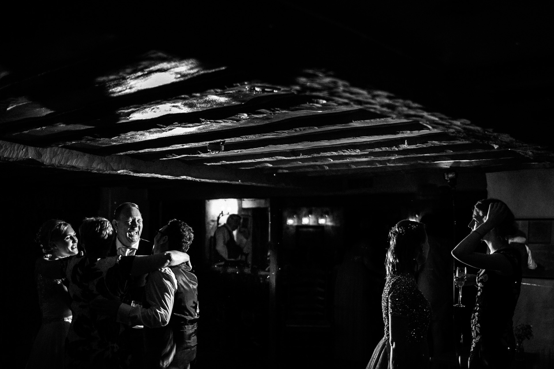 The Wild Boar Wedding Photography - EM - black and white of guests dancing